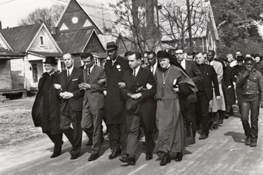 Dana McLean Greeley '31, S.T.B. '33 (second from left), marches with other clergy to the funeral of James Reeb, a Unitarian Universalist minister and a member of Boston's Arlington Street Church. Reeb was slain in Selma, Ala., on March 11, 1965. Photo courtesy of Andover-Harvard Theological Library