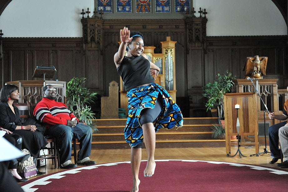Nicole Saxon, M.Div. '12, performs the Yankadi/Makru, a common dance from Guinea, as part of the Wednesday Noon Service hosted by Harambee in 2012. Photo by Steve Gilbert