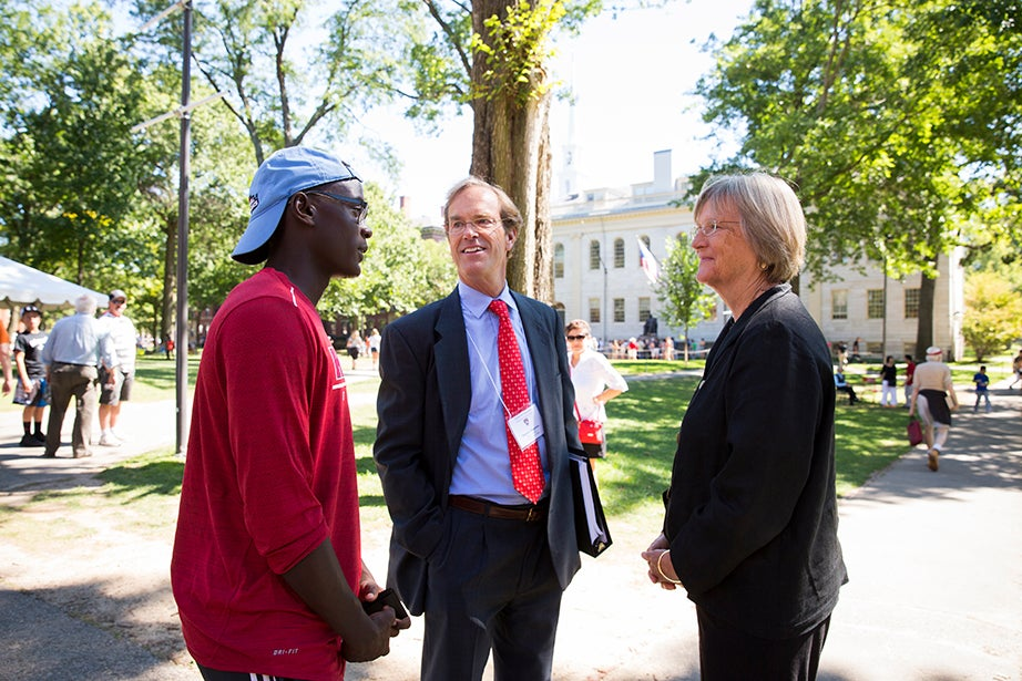 Hailing from Los Angeles, Joel Serugo '20 (left) speaks with Dean of Freshmen Thomas Dingman and Harvard President Drew Faust. Serugo will play soccer for Harvard. Stephanie Mitchell/Harvard Staff Photographer