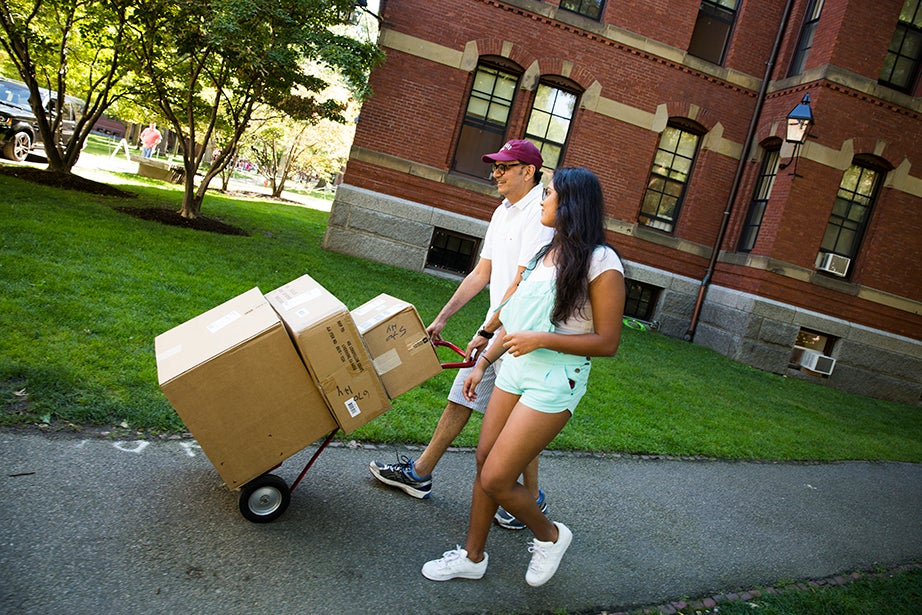 Sam Vora (left) and his daughter Aaki Vora '20 move boxes. Vora moved from Mumbai, India, to her new residence in Harvard Yard. Stephanie Mitchell/Harvard Staff Photographer