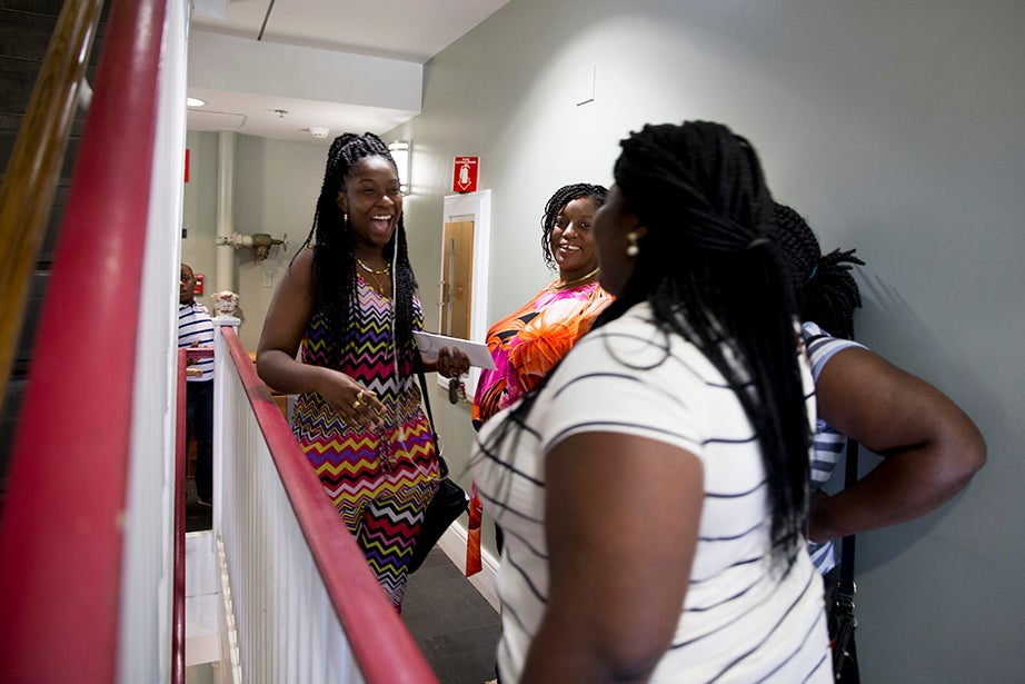 "Kelly Hyles '20 (left) and roommate Simileoluwa Falako '20 meet for the first time during freshman move-in day after getting to know each other over Facebook. Hyles said, ""I'm really excited. This is the first time I'm totally away from my mom and the rest of my family."" Rose Lincoln/Harvard Staff Photographer"