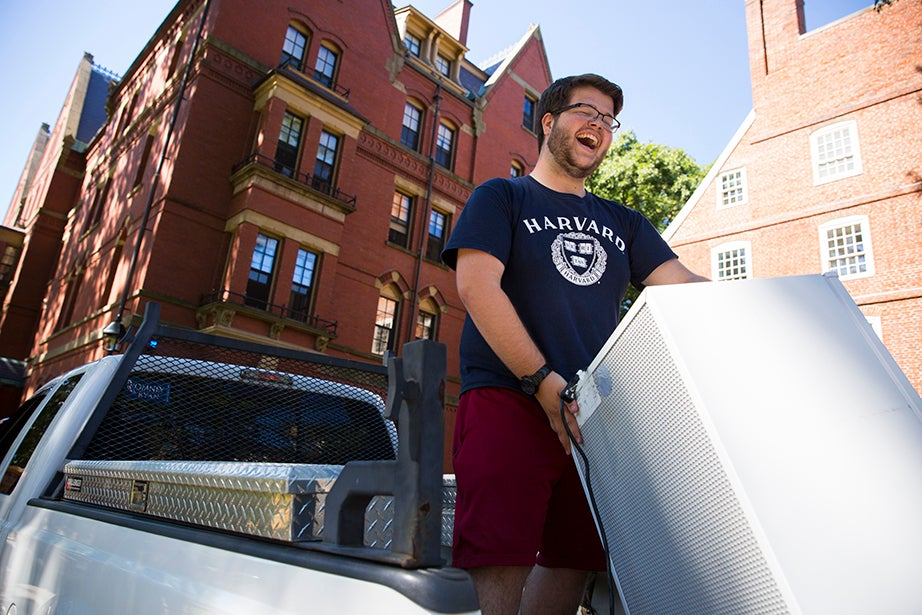 Alex Paladino '20 lifts a refrigerator off the back of his truck in front of Massachusetts Hall. He joins his brother Mike Paladino '17 on campus for his senior year. Stephanie Mitchell/Harvard Staff Photographer