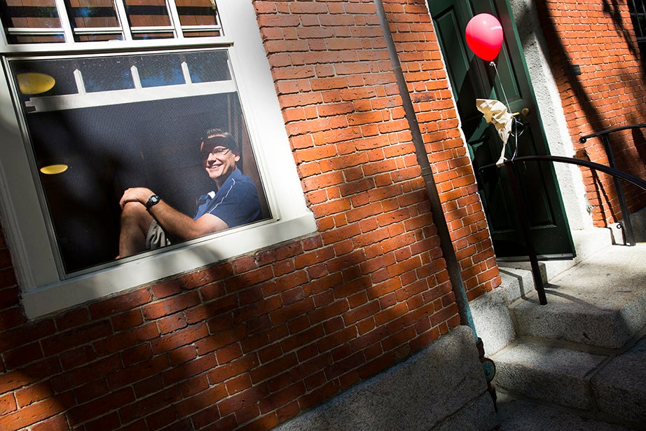 Freshmen move-in day takes place at Harvard University. Karl Bierdumpfel, father of Kyle Bierdumpfel, rests for a moment by the window of Stoughton Hall while moving his son into his room. Stephanie Mitchell/Harvard Staff Photographer