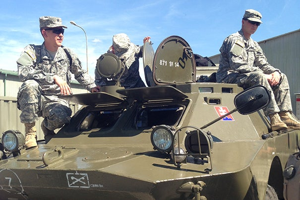 U.S. soldiers relax on top of an old Soviet armored personnel carrier in Rožňava, where the Slovakian CBRN Battalion is stationed.