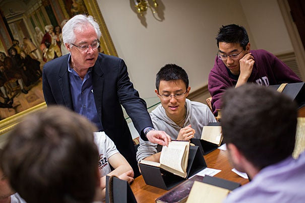 "Louis Menand (left) will be awarded the National Humanities Medal by President Obama. He is pictured with Bowen Lu '17 examining a volume of ""The Brothers Karamazov"" by Dostoyevsky from 1881."