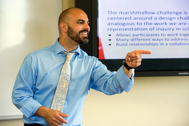 Victor Manuel Pereira Jr. calls on a student during the Harvard Teacher Fellows Program that instructs future teachers how to teach.