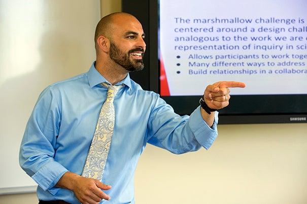 Victor Manuel Pereira Jr. calls on a student during the Harvard Teacher Fellows Program that instructs future teachers how to teach.