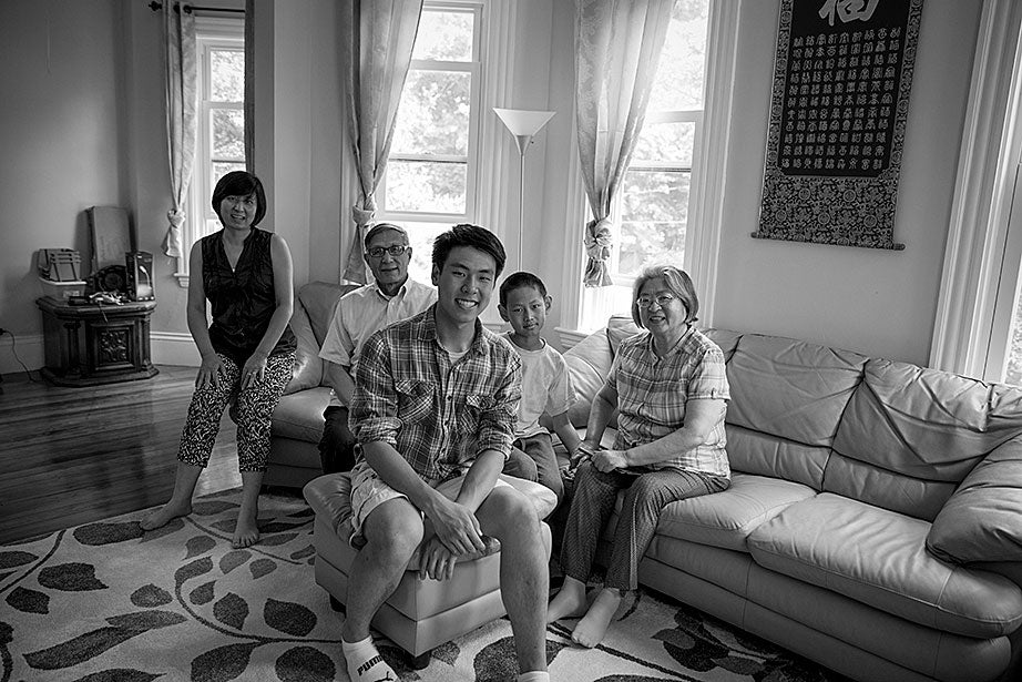 Incoming freshman, Kevin Yang, foreground, and his family, at their home. From left, Yi Jin, Kevin's mother; grandfather, Yongshou Jin; brother, Neil Jin and grandmother, Yi Qun Zhu. His dad, Hailin Yang, not pictured, was at work.