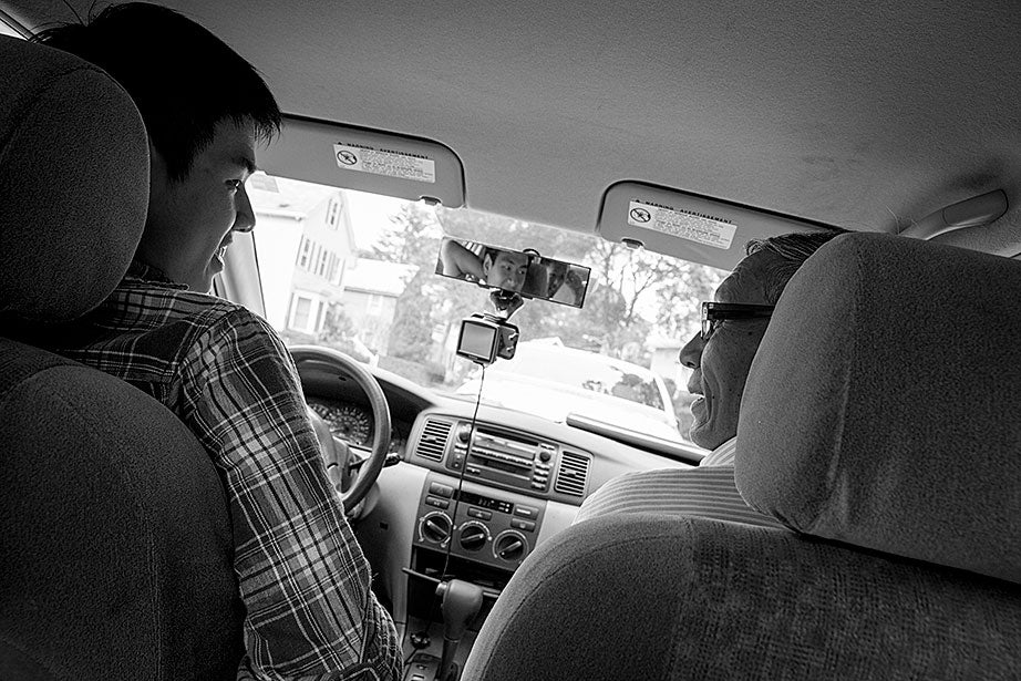For several years, Kevin's grandparents drove him to and from the Ed Portal, school, and other activities. Currently, Kevin is in the driver's seat with his learner's permit while his grandfather instructs him from the passenger seat.