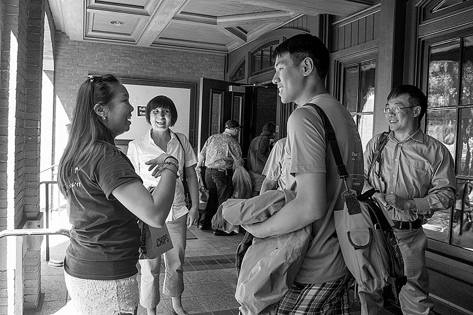 On freshmen move-in day, Kevin, returning from his Freshman Orientation Program (FOP), greets Catherine Zhang '19, on left, while his mother, Yi Jin and father Hailin, look on. Yi Jin rejoiced when she saw her son following his FOP of hiking and camping in the White Mountains of New Hampshire.