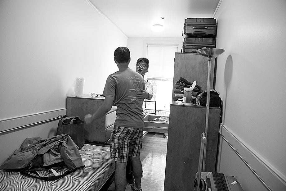 Kevin greets his new roommate, T.J. Song (right) of Gilroy, Calif. They'll share a room, part of a suite in Weld Hall.