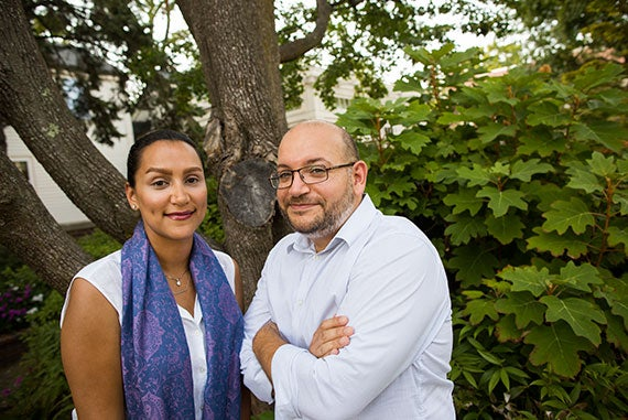 Shorenstein Fellow Yeganeh Salehi (left) and Nieman Fellow Jason Rezaian are pictured in front of Lippman House at Harvard University. Stephanie Mitchell/Harvard Staff Photographer