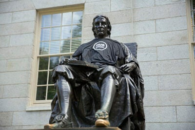 Harvard, one of HUBweek's founders, will host 14 of the 115 events. The John Harvard Statue promotes the Sept. 25-Oct. 1 event.