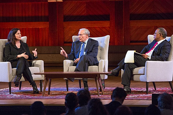 Filmmaker Laura Poitras (left), Washington Post reporter Bob Woodward, and New York Times Executive Editor Dean Baquet engaged in a debate about the quality of mainstream media coverage during the Pulitzer Centennial at Sanders Theatre.