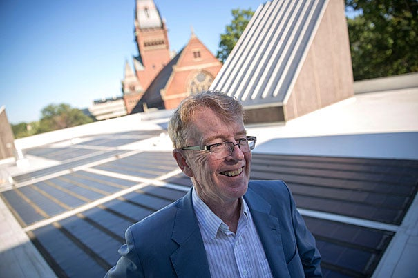 "Atop the roof of the Science Center with solar panels in the background, SEAS/EPS Professor Michael McElroy talks about his new book, ""Energy and Climate: Vision for the Future,"" on the global energy challenge with climate change."