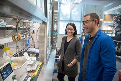 Emily Balskus (left), Morris Kahn Associate Professor of Chemistry and Chemical Biology, and Postdoctoral Fellow Matthew Wilson are co-authors of a study that details the development of a tool that may help researchers better identify enzymes present in microbiomes.