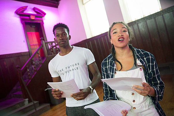 Hakeem Angulu, (from left) ìVoice of Godî, Asia Stewart '18, rehearse Calamus, an original play inspired by Walt Whitmanís poetry inside Leverett House Library Theater. It follows the journeys of Walt, a teenager just out of the closet, and Ford, a young African-American transgendered poet, as they travel across America and into the past. The play showcases the many faces of the BGLTQ+ community today and their relationships with queer history in America. The production kicks off the semester as a staged reading in Leverett Library Theater and includes segments of slam poetry, song, and voiceover. The audience experiences drag queens, intersex butterflies, 1960's homophobes, and 1970's rioters within this original student-written work. Kris Snibbe/Harvard Staff Photographer