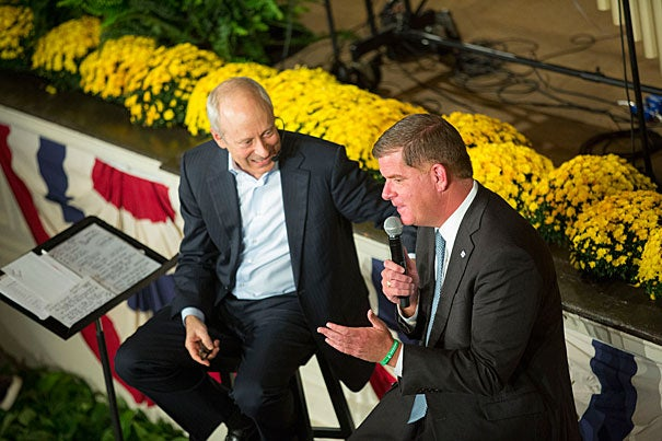Michael Sandel talks with Boston Mayor Martin J. Walsh during the Faneuil Forum HUBweek event inside Faneuil Hall Square in Boston. Kris Snibbe/Harvard Staff Photographer