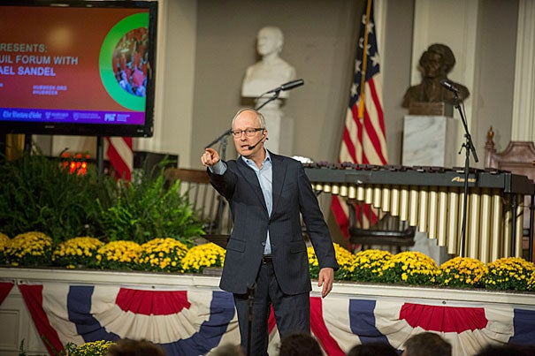 "Harvard Professor Michael Sandel addressed the Faneuil Forum audience as part of HUBweek. ""We're not going to debate about tax policy, Syria, emails, or the wall,"" Sandel told the capacity crowd at Faneuil Hall."