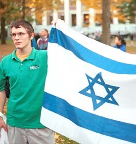 Protester carrying Israeli flag