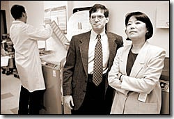 Left to right, Chris Webb, a Research Assistant with Physicians Health Study, stores plasma samples along with Ed Giovannucci and Jing Ma. Kris Snibbe Photo File 13506, # 18A