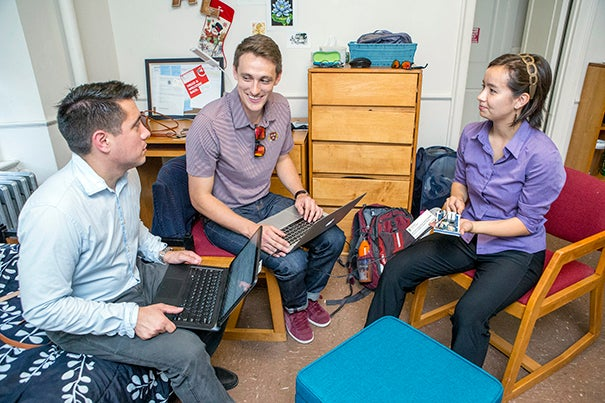 Patrick Kuiper, M.E. '16 (from left), Patrick Day, S.M. '16, and Aldís Elfarsdóttir '18 created a sensor that can gather data on heat and humidity. The goal is to  lower Eliot House's energy use this winter.