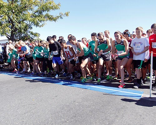 Runners set their feet and watches as they wait for the starting pistol at the 13th annual Brian J. Honan 5K Run. Photo by Stew Milne