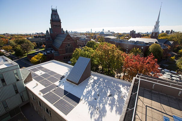 "A view of the Science Center with solar panels on the roof. ""we want to be a living laboratory in how we operate as an organization that uses energy,"" Faust points out. Kris Snibbe/Harvard Staff Photographer"