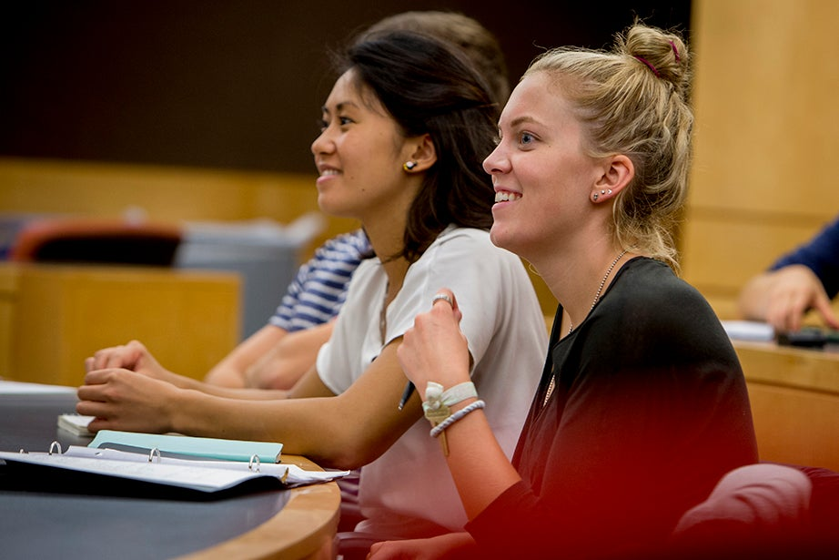 """Jing Leung '18 (left) and Regan Kology '18 take """"Series Expansions and Complex Analysis."""" Rose Lincoln/Harvard Staff Photographer"""