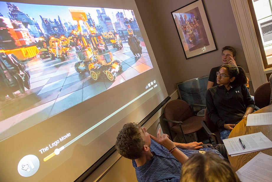 """Students watch a clip from """"The Lego Movie"""" during """"American Economic Fictions."""" Jon Chase/Harvard Staff Photographer"""
