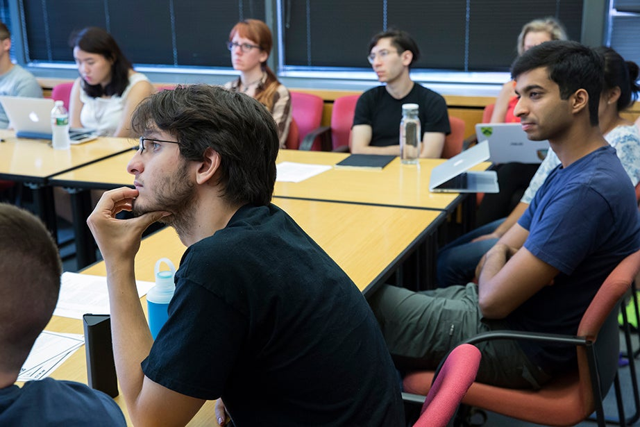 "Alan Bidart '18 (left) listens intently during Virgilio Almeida's class ""The Internet: Governance and Power."" Jon Chase/Harvard Staff Photographer"