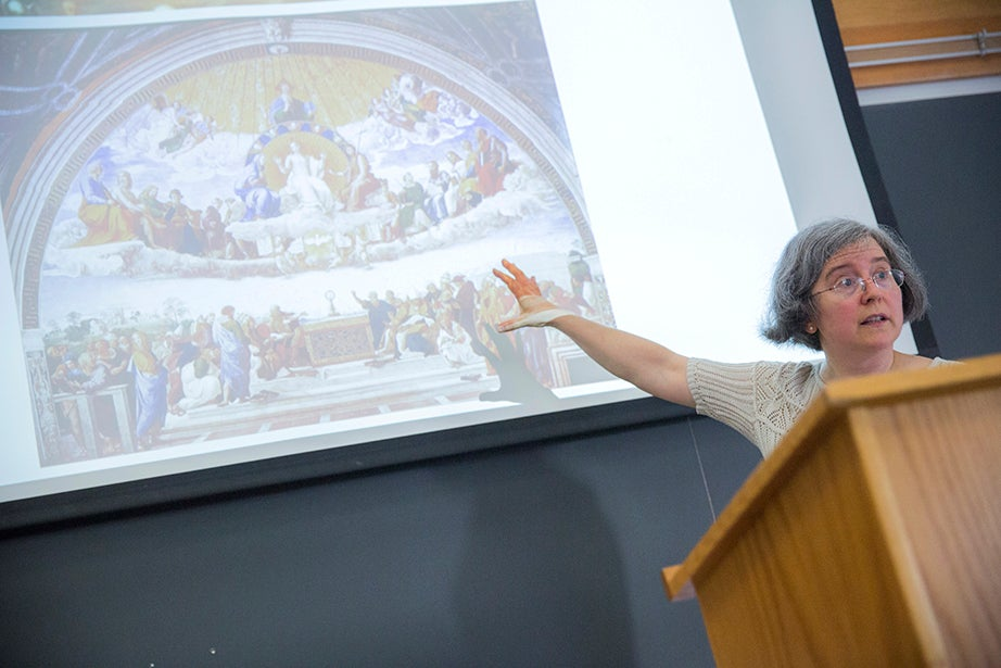 """Ann Blair, Carl H. Pforzheimer University Professor, discusses religion and Raphael's """"Disputation of the Sacrament"""" during """"Reason and Faith in the West"""" in Emerson Hall. This course uses a historical perspective to examine one of the central themes in the Western intellectual tradition: the desire to reconcile rational philosophy with religious and biblical authority. Kris Snibbe/Harvard Staff Photographer"""