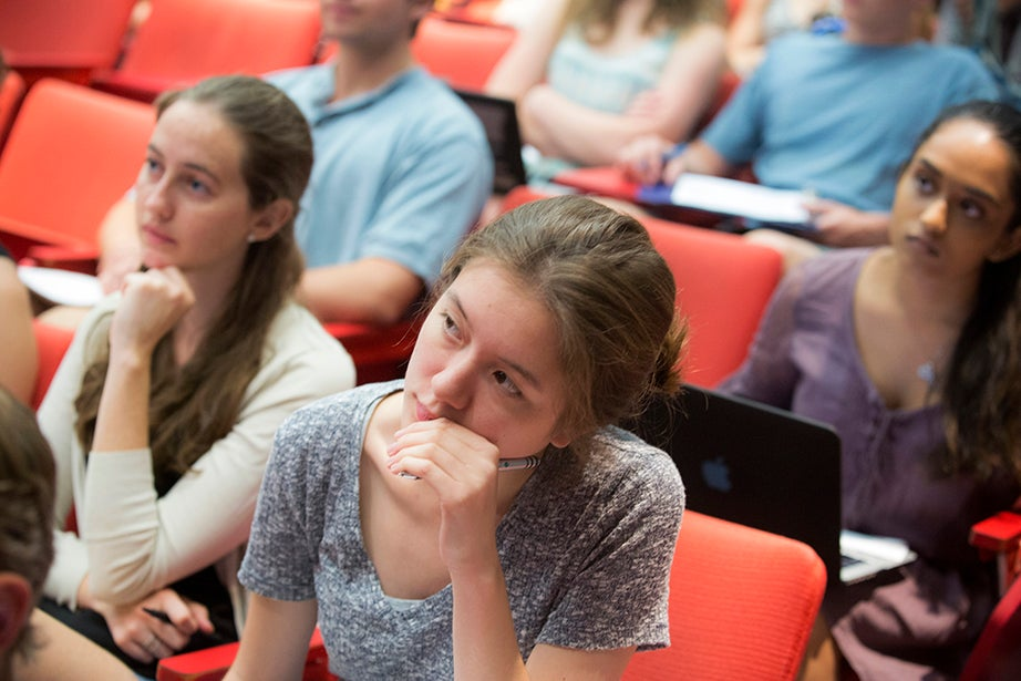 """Jenny Walsh '17 (center) listens during """"Foundations of Biological Diversity,"""" taught by Brian Farrell, director of the David Rockefeller Center for Latin American Studies. Kris Snibbe/Harvard Staff Photographer"""