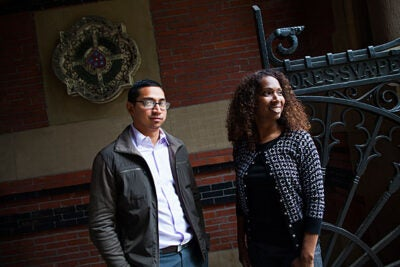 Kalan Chang (left) and Monica Tesoriero are graduates from the Bridge Program, which trains Harvard service workers to move up the ladder. Tesoriero, a cafeteria worker, climbed to administrative director of the Safra Center for Ethics, and Chang, a SEAS custodian, succeeded Tesoriero as the manager for international operations at the David Rockefeller Center.