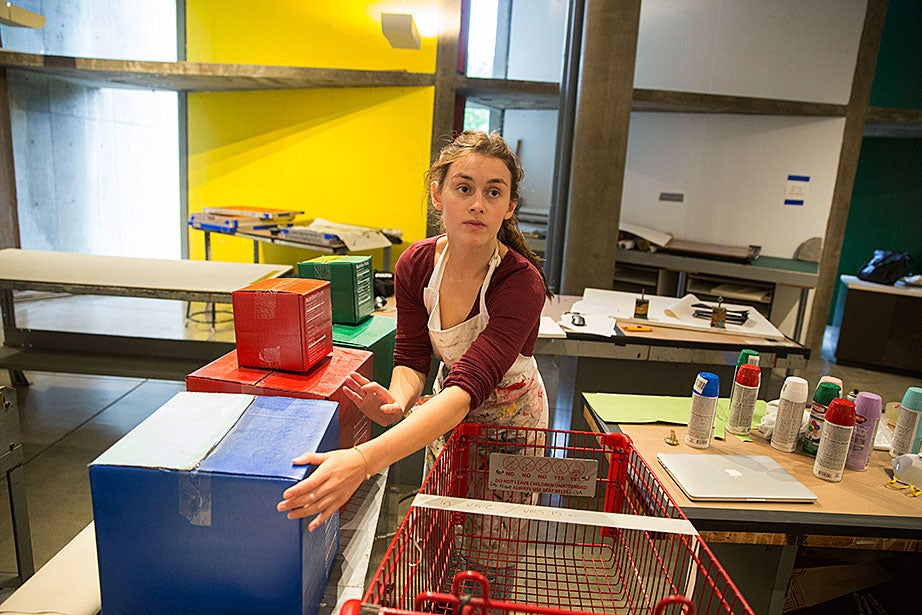 Zoe Oz '17 creates primary color monotypes using boxes and mixed-media during Silkscreen, taught by Annette Lemieux, in the Carpenter Center.