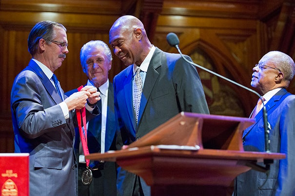 David Lattin from the 1966 Texas Western National Champions Basketball Team receives his award from Glenn Hutchins, left, as former Los Angeles Lakers coach Pat Riley, second from left, and Hutchins Center director Henry Louis Gates, Jr., far right, look on. Actress Pam Grier and Soprano Jessye Norman were among the recipients of Harvard UniversityÕs Hutchins Center for African & African American Research 2016 W.E.B. Du Bois Medals. Also receiving awards: Ursula M. Burns, Harvard Senior Admissions Officer David L. Evans, Lana ÒMC LyteÓ Moorer, David Simon, and Willie Worsley and David Lattin from the 1966 Texas Western National Champions Basketball Team. Jon Chase/Harvard Staff Photographer