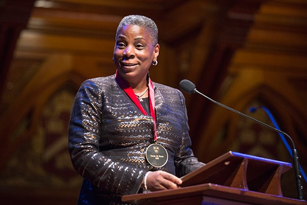 "Ursula M. Burns, chairman and chief executive of Xerox Corp., was the first African-American woman to lead a Fortune 500 company. Burns recalled how her mother stressed the importance of education as ""not only the way up but the way forward."" Jon Chase/Harvard Staff Photographer"