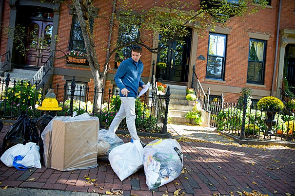 Jackson Allen '18 walks the streets of the South End. Rose Lincoln/Harvard Staff Photographer