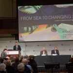 Melting Arctic ice is opening the Northwest Passage, just a symptom of the accelerating warming in the Arctic and around the globe, speakers at a Radcliffe symposium on the oceans said.