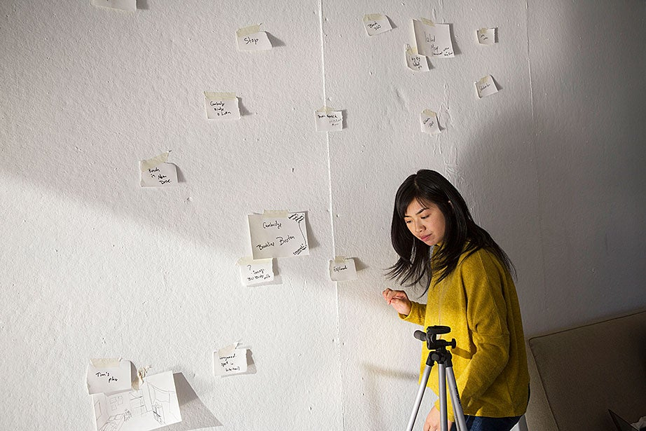 GSD student Jane Zhang studies a wall used for brainstorming visual sequences during Stephen Prina's Lay of the Land class.