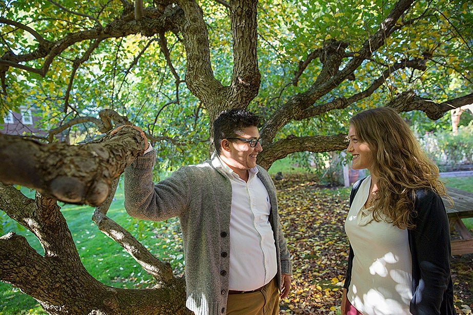 "Nina Bryce (right) and her fiancé, Soltan Bryce, talk beneath a canopy of foliage in the Center for the Study of World Religions garden. ""As an interfaith couple, making the CSWR our home this year has been a beautiful experience. The resident community celebrates learning from one another while exploring complex questions related to religion,"" said Bryce."