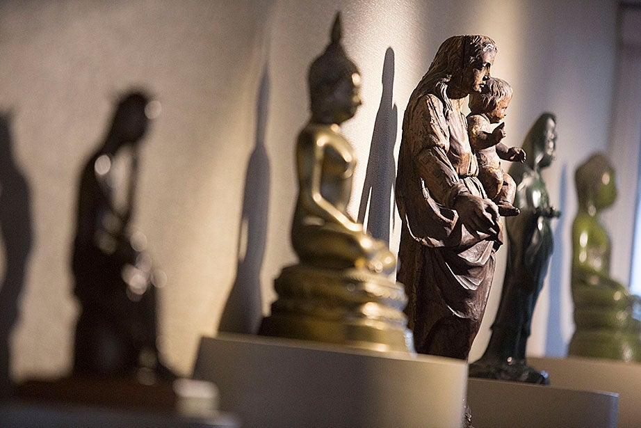 Christian and Buddhist statues are displayed together at the Center for the Study of World Religions.