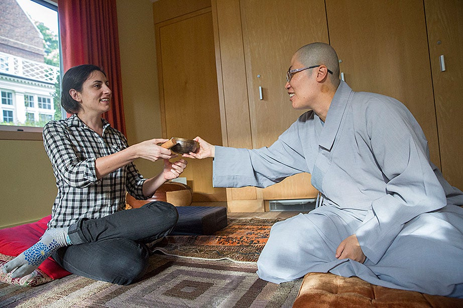 "GSAS student Sara Klingenstein (from left) and the Ven. Changshen Shi discuss ritual in different religious traditions. ""People in CSWR are peaceful, thoughtful, and encompassing,"" said Shi. ""The beautiful combination of our differences and common interests makes me feel grateful to live in this spiritual and colorful pure land."""