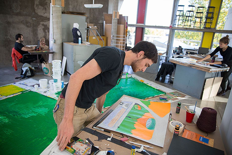 Michael Rothberg '17 paints during Stephen Prina's Lay of the Land class where students work independently in the studio space in the fifth floor studios.