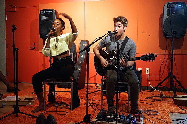 Eden Girma '18 gets the audience snapping to covers of Lianne La Havas as Alex Graff '17 doubles up on voice and guitar accompaniment. The concert was the start of something new at the SOCH Penthouse.