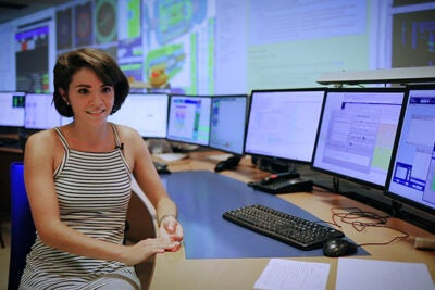"Harvard Ph.D. candidate Karri DiPetrillo doesn't mind working the overnight shift in the ATLAS control room. ""You can think of ATLAS as always taking data so we always need people watching it,"" she says."