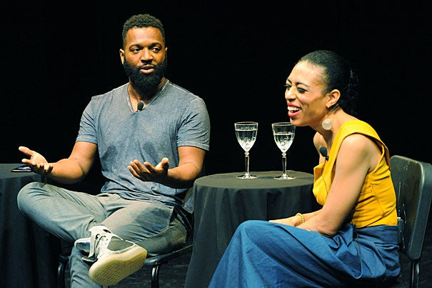 "Baratunde Thurston '99 and Candice Hoyes '99 discuss their experiences as black artists at a recent Harvard Alumni Association event in New York. ""I think sometimes the isolation of being the only black kid helped to drive my excellence,"" said Hoyes, ""because it didn't seem foreign to me to be in a room studying or working for stretches of hours."""