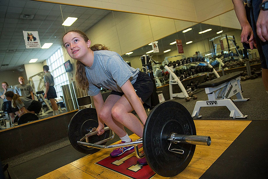 Army ROTC cadet Alannah O'Brien '19 performs a deadlift during physical training exercises at Harvard's Murr Center. ROTC requires a demanding array of push-ups, squats, and weight-lifting exercises.