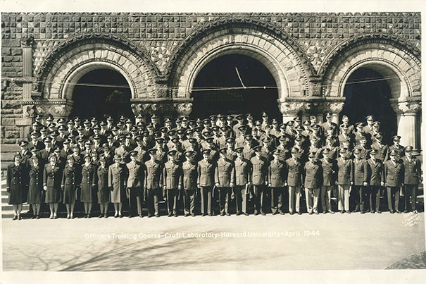 """A photo from the exhibit """"To Serve Better Thy Country,"""" depicting ROTC cadets gathering for a photo in front of Crufts Laboratory, April 1944."""