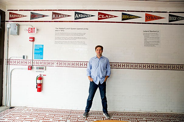 Ayr Muir, founder and CEO of Clover Food Lab on Massachusetts Avenue in Harvard Square, uncovered old tiles depicting collegiate iconography when renovating the space that his store now occupies.